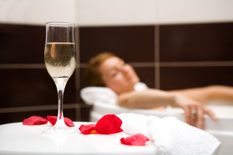 Image of romantic bath with rose petals and candles