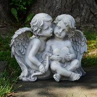 "16.25"" Sitting Cherub Angels Holding a Heart and Bow Garden Statue"