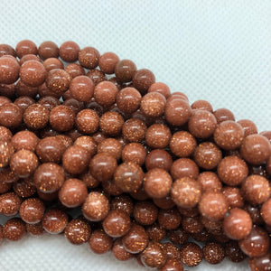 Brown Goldstone - Synthetic - 8 mm Round - Per Strand Approx. 48 Beads