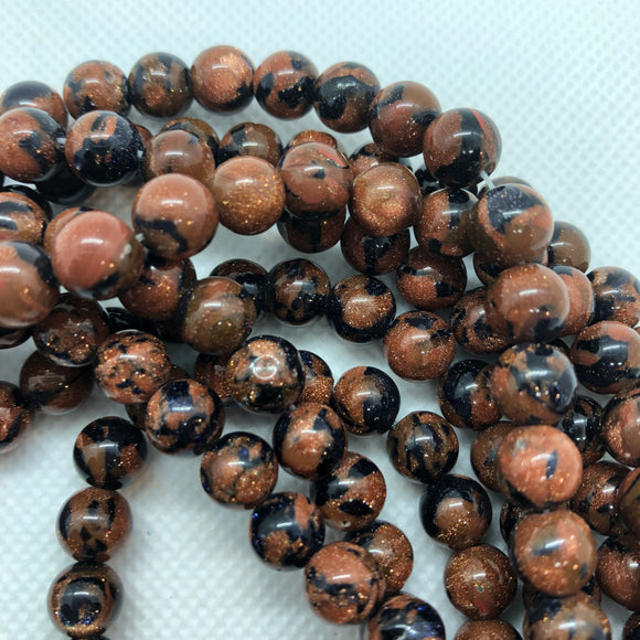 Fusion Goldstone - Synthetic - 8 mm Round - Sold Per Strand Approx 48 Beads