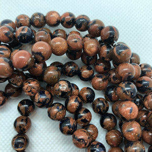 Fusion Goldstone - Synthetic - 6 mm Round - Sold Per Strand Approx 64 Beads
