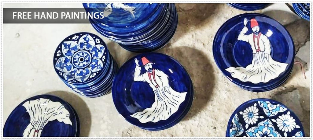 Free hand paintings blue pottery
