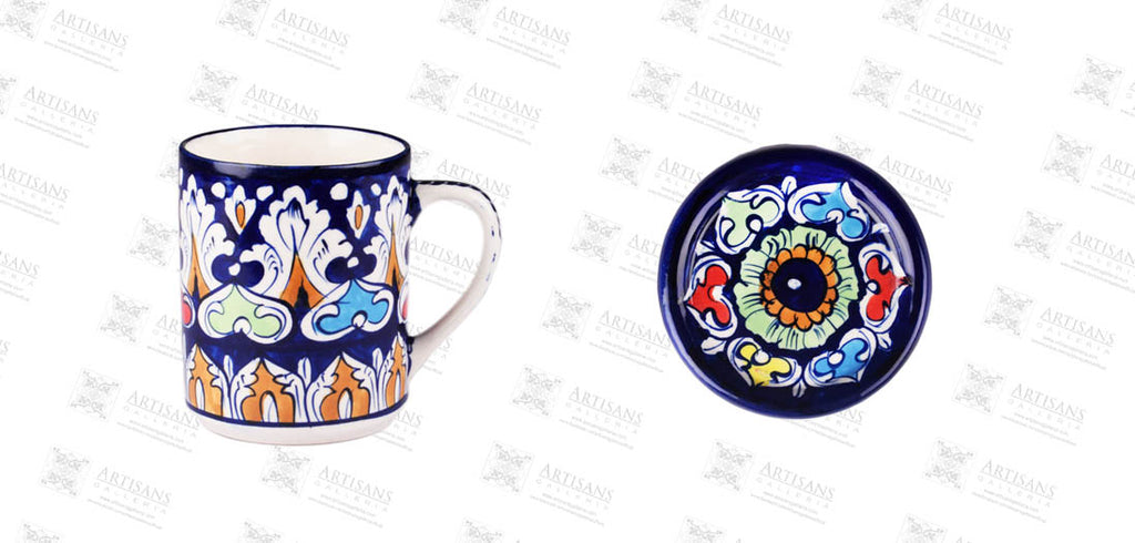Benita David shows blue pottery vinca colorful mug