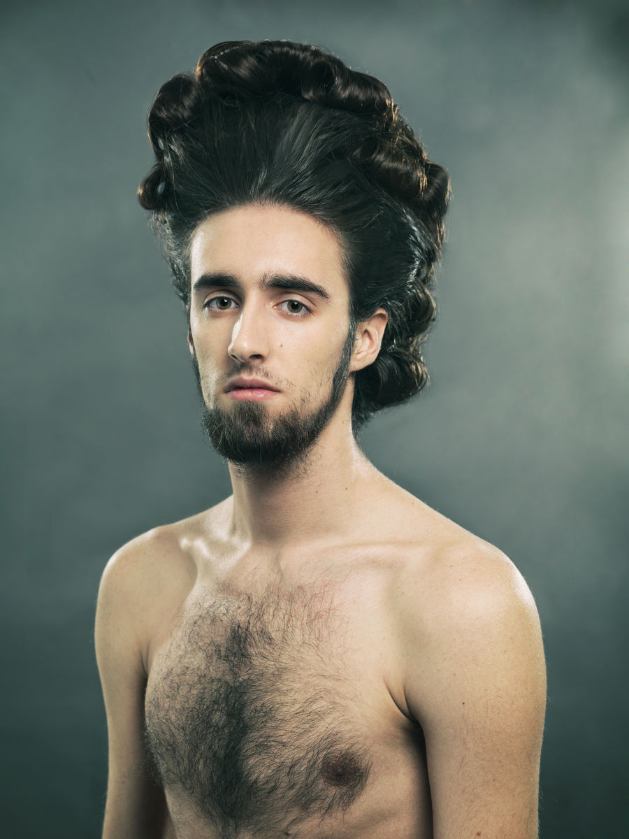 man with 18th century hair style