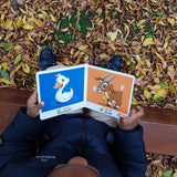 African boy reading bilingual books