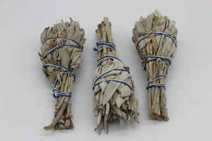 3 MINI CALIFORNIAN WHITE SAGE SMUDGE STICKS PREMIUM QUALITY. These smudge sticks are tied together with a natural white and blue cotton. These premium quality White Sage Smudge sticks are approx. between 10 to 13 cm in length.  The smudges are used for cleansing  These small torches are very popular and when used are a perfect way to cleanse  your home in a more natural way than artificial air fresheners leaving you and your home refreshed.