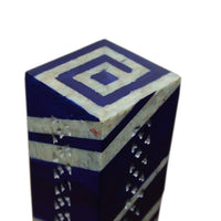 top half view of rectangle upright incense burner with stripes going all around and maze pattern on top