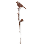 Black-Capped Chickadee on branch - rusted arts in garden