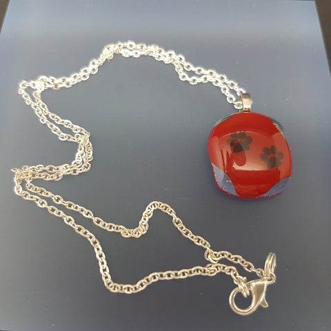 Red Glass fused  Pendant  with dog paw black detail strung on silver plated chain