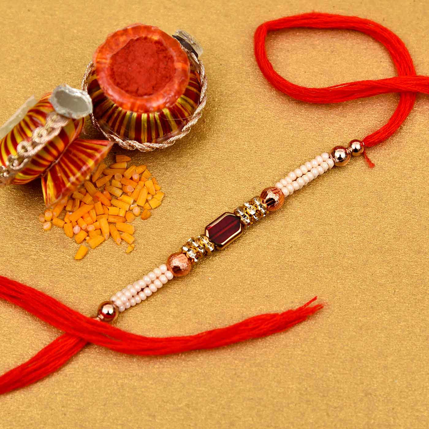 Pearl With Red Stone Rakhi