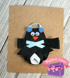 Penguin ribbon sculpture hair bow with earmuffs and scarf front view single blue