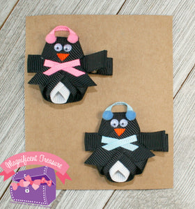 Penguin ribbon sculpture hair bow with earmuffs and scarf front view 2 colors