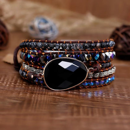 Triple Wrap Bracelet with Tigers Eye, Mid-night, and Copper Beads on a Wooden Surface
