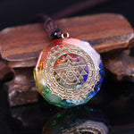 orgonite necklace leaning on a wood surface