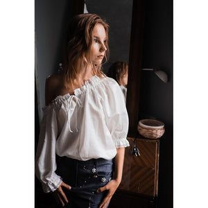 Off-the-shoulders white silk blouse