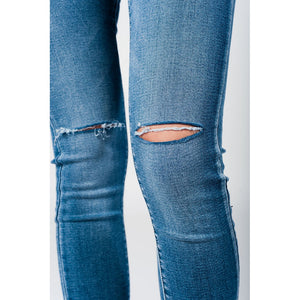 Skinny jeans in midwash with busted knees and chewed hems - Modern Choices