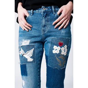 Mom jeans with cloth and embroidered floral patches