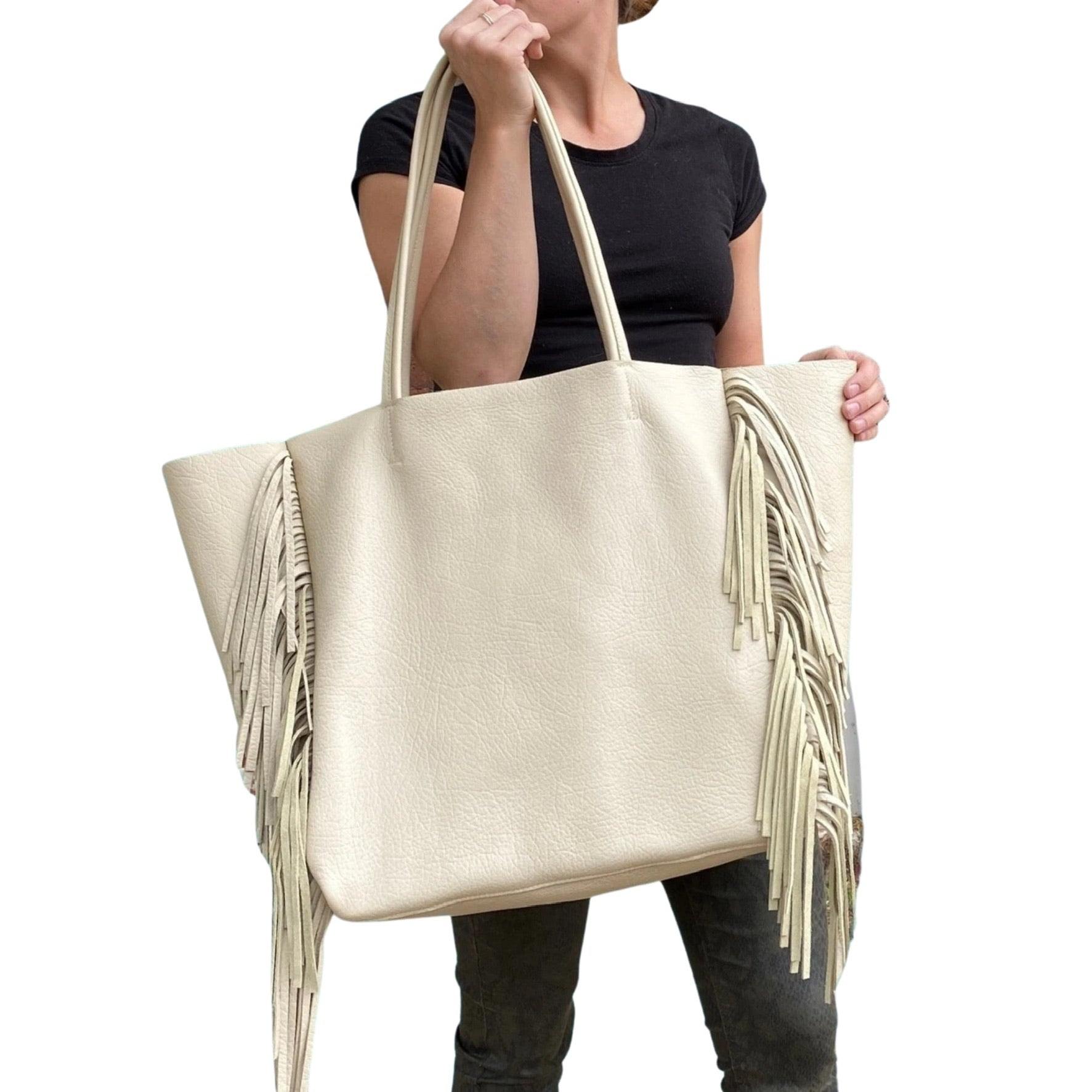 Handmade off white leather tote with side fringe