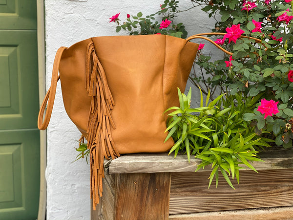 Handmade leather tote with side fringe