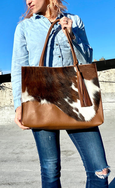 Raw edge brown cowhide leather tote
