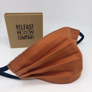 Handmade Face Covering in Burnt Orange for women washable and reversible by the Belfast Bow Company