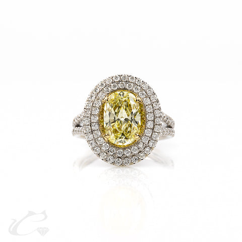 Natural Yellow Oval Diamond in a Double Halo Ring