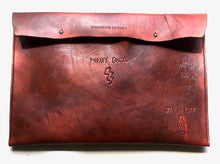 This deep brown cool custom tattoo leather laptop case will protect & flatter any size laptop Made with 100% vegetable tanned leather that is all hand tooled & carved Made in USA