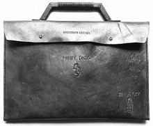 This cool black custom tattoo leather laptop case will protect & flatter any size laptop Made with 100% vegetable tanned leather that is all hand tooled & carved Made in USA