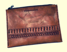 Beautiful custom leather boho zipper bag with hand stamped pattern