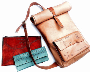 This beautiful leather collection of custom bags has hand carved tattoos