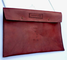 This deep red cool custom tattoo leather laptop case will protect & flatter any size laptop Made with 100% vegetable tanned leather that is all hand tooled & carved Made in USA