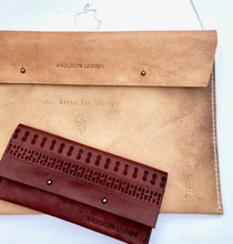 These two cool custom leather accessories by Brooklyn Leather feature a tattoo leather laptop case and a boho carved leather wallet.