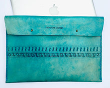 this genuine bohemian leather laptop case is hand carved and dyed turquoise