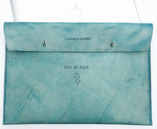 This cool turquoise custom tattoo leather laptop case will protect & flatter any size laptop Made with 100% vegetable tanned leather that is all hand tooled & carved Made in USA
