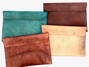 This collection of cool custom leather laptop cases feature custom carved tattoos and original colors.   Will protect your laptop and finally make you look cool.