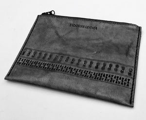 Our black custom boho leather zipper bag clutch