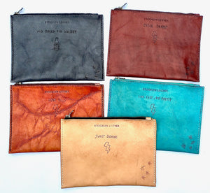 Custom dye rubbed leather zipper bags with motorcycle inspired tattoos