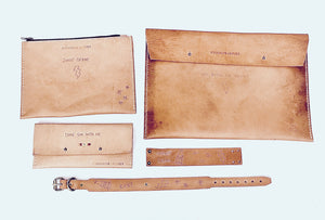 This full collection of cool natural custom tattoo leather accessories include a leather laptop sleeve, boho leather wallet, custom leather zipper pouch and leather wrist cuff.