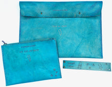 This full collection of cool turquoise custom tattoo leather accessories include a leather laptop sleeve, boho leather wallet, custom leather zipper pouch and leather wrist cuff.