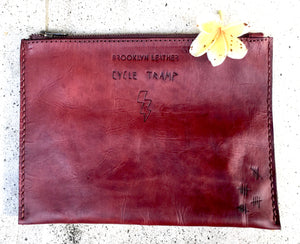 Our motorcycle inspired custom leather bag clutch with carved tattoos
