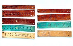 All the colors and styles of our custom leather wrist cuffs in boho and tattoo