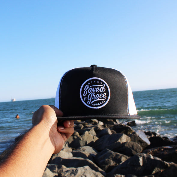 Saved by grace black and white trucker hat