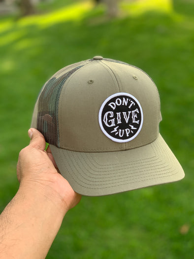 Don't give up green camo trucker hat