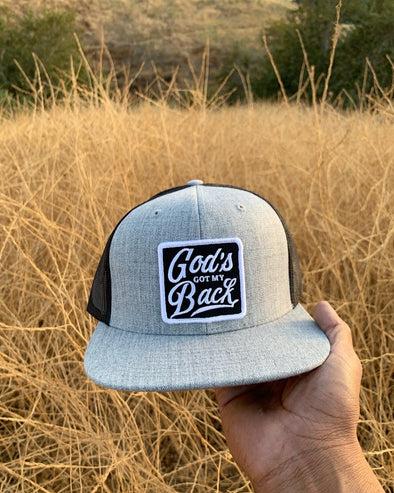God's got my back gray and black trucker hat