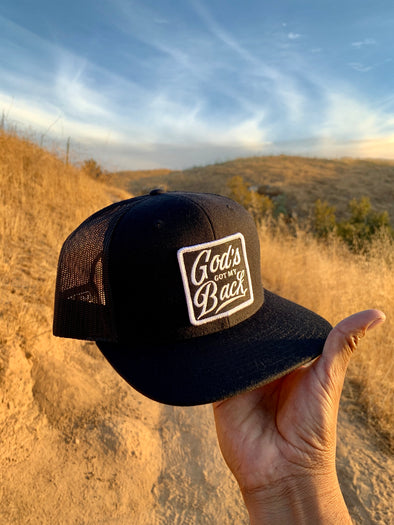 God's got my back black trucker hat