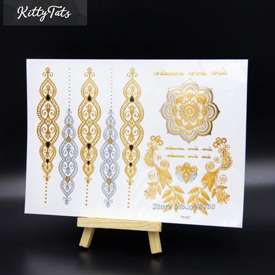 Intricate gold and silver henna style relief selection