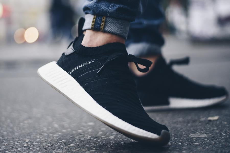 uk availability daa41 083be NMD R2 PK Japan Black Gum - ENStest