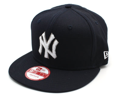 NEW ERA 9FIFTY SNAP BACK CAP. NEW YORK YANKEES TEAM CHENILLE. NAVY from peaknation.co.uk