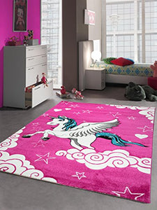Girls pink unicorn themed rug for bedroom, would look perfect in a playroom or nursery. Unicorns clouds and stars!