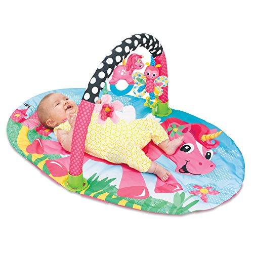 unicorn themed play mat with toys, bright and colourful